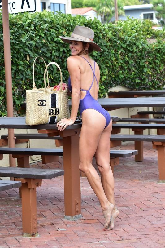 charming milf Brooke Burke Charvet in purple swimsuit