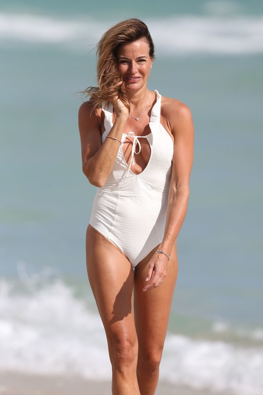 chamring milf Kelly Bensimon in white one piece swimsuit