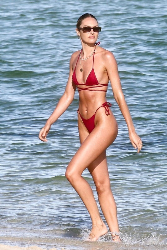 good-looking babe Candice Swanepoel in wet red bikini