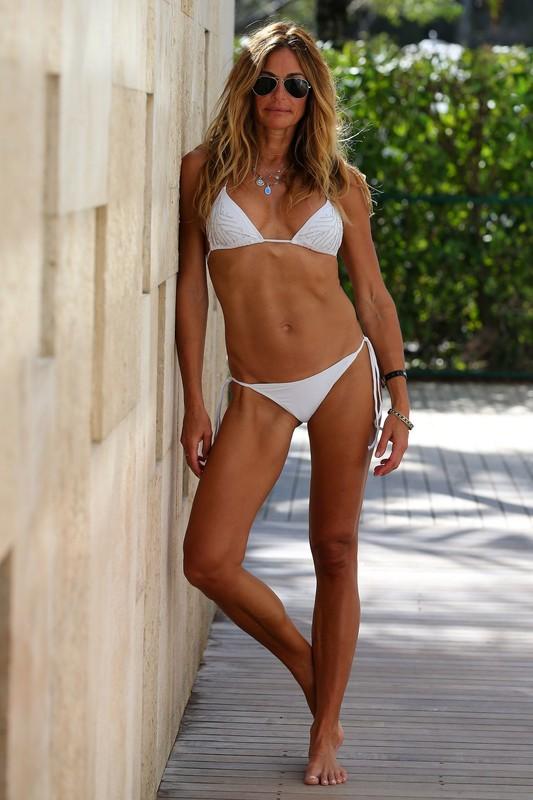 gorgeous milf Kelly Bensimon in sexy white bikini