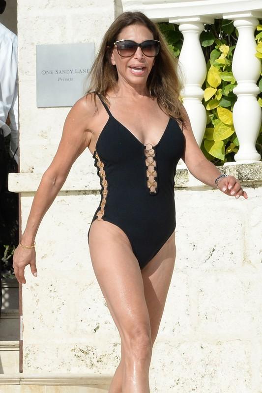 charming milf Terri Seymour in black 1 piece swimsuit