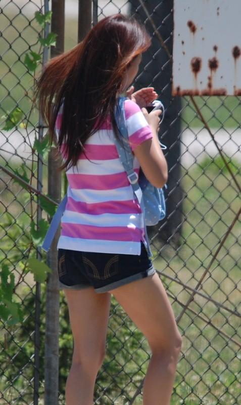 petite college female in denim shorts