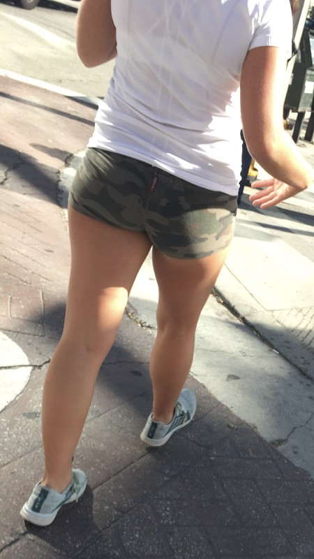 blonde lady in camouflage shorts